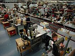 Leather workers inside the Mulberry factory in Shepton Mallet in Somerset. More than 300 are now being tested for TB after two staff members were diagnosed with the condition