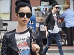 Sassy in the city: Krysten Ritter looked street chic in a Rolling Stones T-shirt, ripped skinny jeans and a black leather biker jacket, as she stepped out in New York's Soho neighbourhood on Sunday