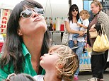 Priceless: Selma Blair and her son Arthur made matching kissy faces at the Farmers Market in Studio City, California on Sunday