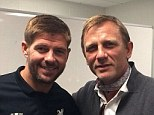 Double act: Daniel Craig visited the Liverpool dressing room and posed with captain Steven Gerrard