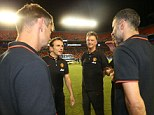 Louis van Gaal of Manchester United speaks to his coaching staff after the pre-season friendly