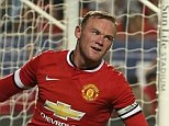 Delighted: Striker Rooney wheels off in celebration after bringing United level in Miami
