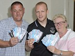 Gesture: Everton striker Naismith with the tickets at a Job Centre Plus in Liverpool