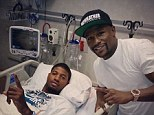 Visitor: Floyd Mayweather went to see Paul George in hospital after he suffered a broken leg
