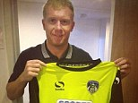 Fresh start? Former Manchester United midfielder Paul Scholes poses with Oldham Athletic's new away shirt