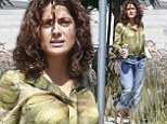 Make-up free Salma Hayek enjoys relaxed stroll with her dog days after attending Beyonce and Jay Z show