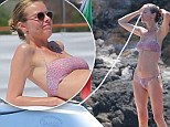 Eva Herzigová takes to the water as she continues to show off her stunning frame on Italian break with partner Gregorio Marsiaj
