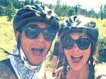 But first let me take a selfie! Lewis Hamilton and girlfriend Nicole Scherzinger pose for pictures on mountain biking excursion