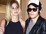 New girlfriend? James Franco is spotted rushing through LA airport with beautiful mystery blonde who shows off her legs and midriff in tiny Daisy Dukes
