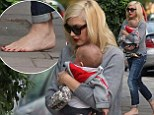 Baby steps: Gwen Stefani arrives home barefoot after enjoying day out with husband Gavin Rossdale and son Apollo