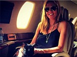 Heidi Klum shows off new feline friend on her private jet after visiting artist Donald Judd's museum in Texas
