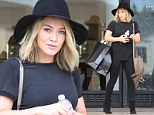 Hilary Duff cuts a fashionable figure in an all-black ensemble featuring a large black fedora as she shops in Beverly Hills