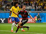 Germany's forward Thomas Mueller (R) celebrates his team's sixth goal, scored by Germany's forward Andre Schuerrle (not seen), as Brazil's defender Dante (L) reacts during the semi-final football match between Brazil and Germany at The Mineirao Stadium in Belo Horizonte during the 2014 FIFA World Cup on July 8, 2014.  AFP PHOTO / FABRICE COFFRINI        (Photo credit should read FABRICE COFFRINI/AFP/Getty Images)