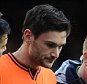 Hugo Lloris of Tottenham Hotspur leaves the field through injury during the Barclays Premier League match between Everton and Tottenham Hotspur at Goodison Park in Liverpool, England on November 03, 2013.   LIVERPOOL, ENGLAND - NOVEMBER 03:  (Photo by Chris Brunskill/Getty Images)
