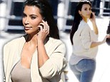 Did you call the 'booty tailor'? Kim Kardashian lets her jeans do the talking as she arrives for appearance on Jimmy Kimmel