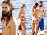Soaking up all the attention! Shirtless Jared Leto frolics with three bikini-clad beauties on the beach in Ibiza