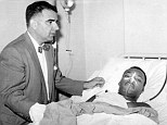 Martin Luther King pictured in his hospital bed following the 1958 stabbing beside Dr Emil Naclerio