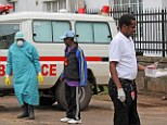 Health workers outside Connaught Hospital, after the arrival of a patient with symptoms of Ebola in Sierra Leone's city of Freetown