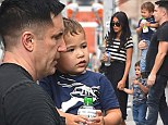 Hard core rocker Trent Reznor shows a soft side as he dotes on his sons during a family day out