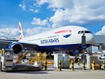 D1KEER british airways plane ready for boarding being loaded with luggage and meals Heathrow Airport Terminal 5 London UK GB EU Europe