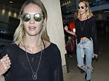 Sexy style: Candice Swanepoel displayed her taut tummy as she arrived at Los Angeles International Airport on Tuesday