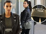 Kim Kardashian's booty is off duty as she covers curves in baggy Yeezus top after Twitter meltdown over weight gain