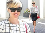 Making a fashion statement in the office! Stylish Reese Witherspoon steps out in professional pencil skirt and checkered top