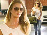 Modest model: Rosie Huntington-Whitetely covered up her slim shape with a white blouse and cuffed skinny jeans as she strolled through Beverly Hills
