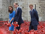 The Duke and Duchess of Cambridge  with Prince Harry view the Tower of London's 'Blood Swept Lands and Seas of Red' poppy installation to commemorate the 100th anniversary of the outbreak of First World War. PRESS ASSOCIATION Photo. Picture date: Tuesday August 5, 2014. See PA story HISTORY Centenary . Photo credit should read: John Stillwell/PA Wire