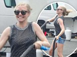 Amanda Seyfried smiles as she struggles with rope exercises while on the set of Ted 2