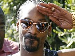 Hippie chic: Snoop Dogg wore heart-shaped glasses in Saint Tropez today