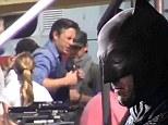 It's Bruce Wayne! Ben Affleck swaps Batman suit for shirt and streak of grey hair on set of new movie