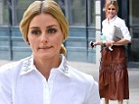 Style icon: Olivia Palermo sported a long vintage leather skirt paired with a crisp white blouse with a rhinestone encrusted collar in New York on Monday