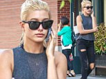She could talk all day! Chatty Hailey Baldwin is glued to her phone as she strolls through New York City