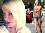 'I chopped it all off myself': Tori Spelling debuts shorter haircut as her weight 'continues to drop on 500 calorie-a-day diet'