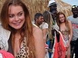 She's no mean girl! Lindsay Lohan stops to take a snap with some of the locals as she enjoys getaway in Greece