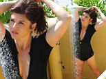 Tiffani Thiessen shows off her stunning figure in plunging cropped wetsuit she she takes beachside soak