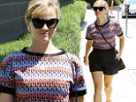 The Legally Blonde star wore a red, white, and blue patterned top tucked into a pair of tiny black shorts while in the city's near-90-degree heat.