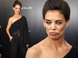 Katie Holmes makes a funny face while going glam in sheer black blouse and trousers at Life Is Amazing premiere