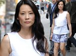 Lucy Liu, 45, looks like she could use a good nap on set of Elementary with co-star Johnny Lee Miller