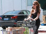 Ashley Greene dresses up for a trip to the grocery store in Los Angeles wearing a tight, black dress