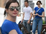 Rut roh! Anne Hathaway wears unflattering denim slacks during coffee break with husband and two dogs in Brooklyn