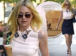 Her name is Joe? Dakota Fanning carries iced coffee labeled with the wrong name while showing off toned legs in NYC