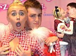 That's why she's so popular! Miley Cyrus enjoys a 'grope and greet' session with her No. 1 fan after steamy 'French kiss'