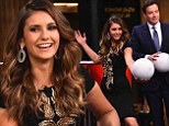 She's got some skills! Nina Dobrev competes against Jimmy Fallon for a likely game of beer pong