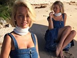 Denim diva! Lara Bingle ditches her string bikini for a VERY different look as she braves the cold at secret location