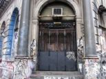 With graffiti covering the imposing doorway and first two floors, many had believed the building was vacant