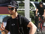 Ryan Kwanten flaunts his bulging biceps as he gives his strong legs a workout during a post-gym bike ride
