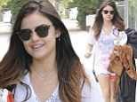 Pretty Little Liars' Lucy Hale is just an average girl in shorts and T-shirt as she carries her own garment bag to a meeting