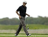 This Aug. 12, 2013 photo shows President Barack Obama as he steps onto a tee while golfing at Vineyard Golf Club in Edgartown, Massachusetts, on the island of Martha's Vineyard, during his vacation there last summer. The White House says the president plans to return to Martha's Vineyard tomorrow regardless of the situation in Iraq